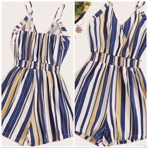 A blue,yellow and white striped romper